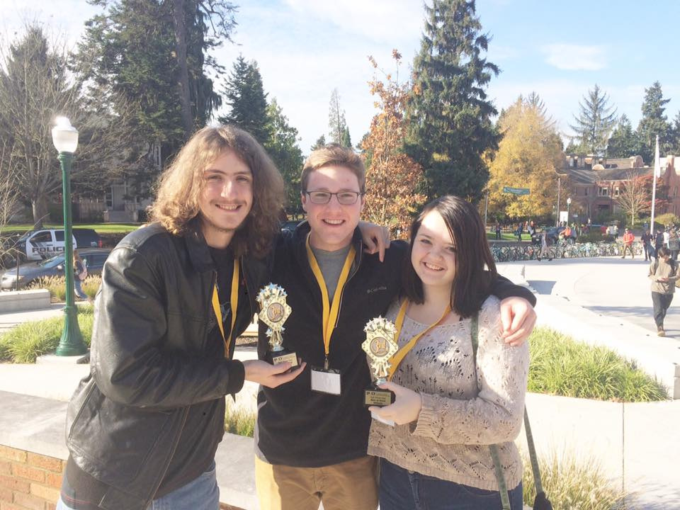 Clarion reporter Bart Brewer (left) along with Editors-in-Chief Conor Bergin (center) and Ashley Lytle (right) pose with their newly received trophies.