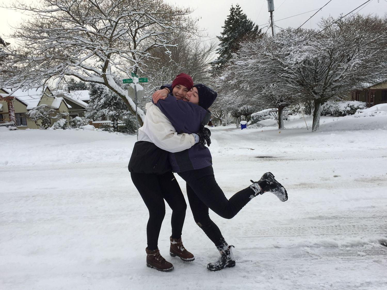 Seniors Elena Matt and Luisa Potestio spend the day outside enjoying a snow covered Portland. Image provided by Elena Matt.