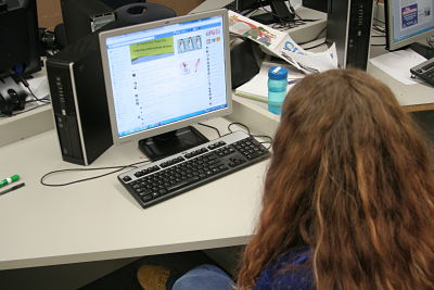 A student reads the growing comment thread on a Facebook post.