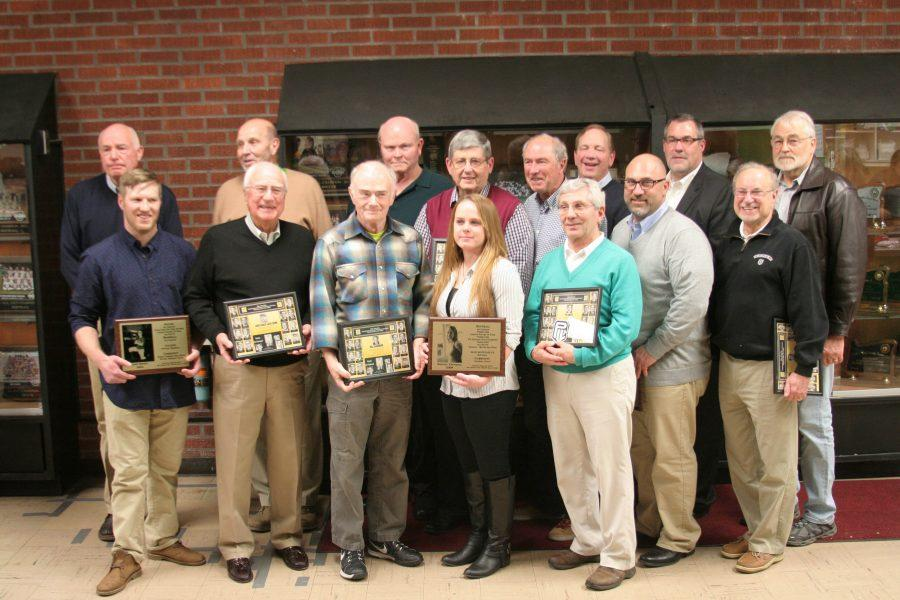 All+of+the+inductees+pose+together+with+their+plaques.