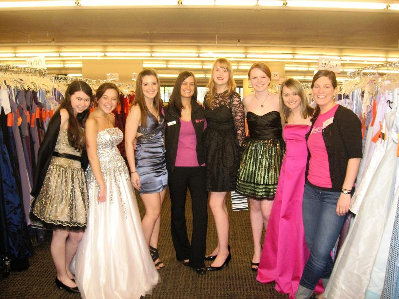 Girls try on the dresses at the Abby's Closet prom dress give away.