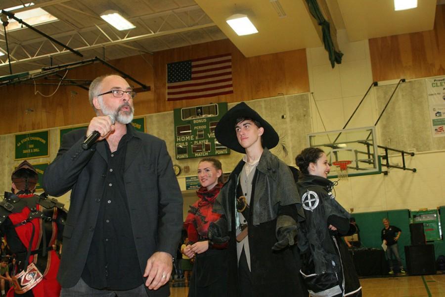 Drama teacher Tom Beckett talks in the activities showcase