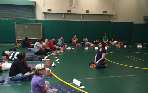Students work on meditation techniques during the yoga and mindfulness class