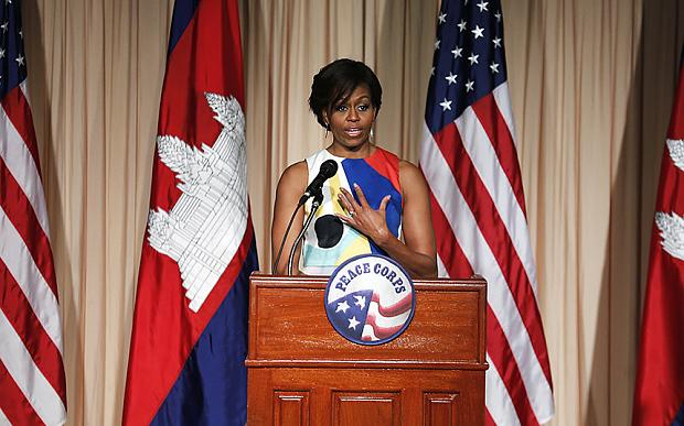 U.S. first lady Michelle Obama waves as she arrives to speak to the Peace Corps, Saturday, March 21, 2015, in Siem Reap, Cambodia. Mrs. Obama is in Cambodia to promote the education initiative