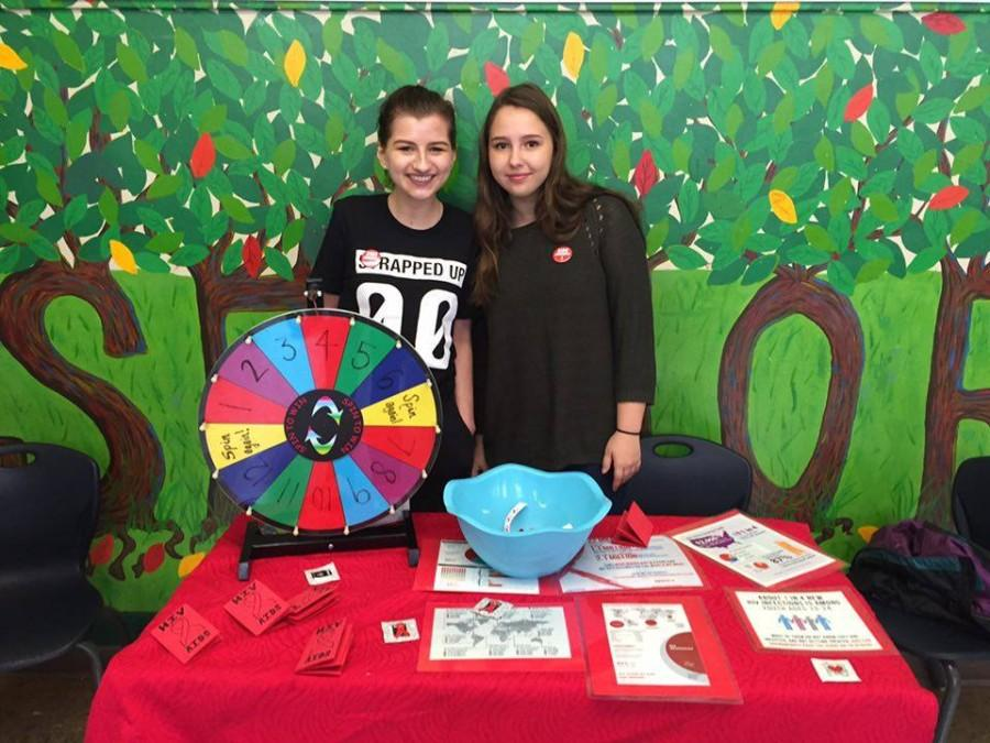 Clara Rehmann and Annabelle Schwartz run a booth to help educate people on HIV and AIDS. Cyrus Lyday photo.