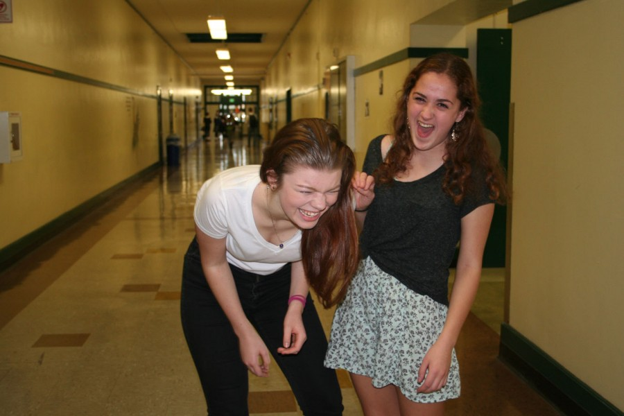 Senior Kira Rea and Grace Benefiel have a laugh in the halls of CHS