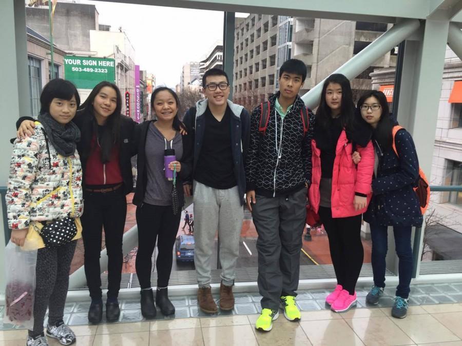 Four Suzhou students take a photo during a tour of downtown Portland.