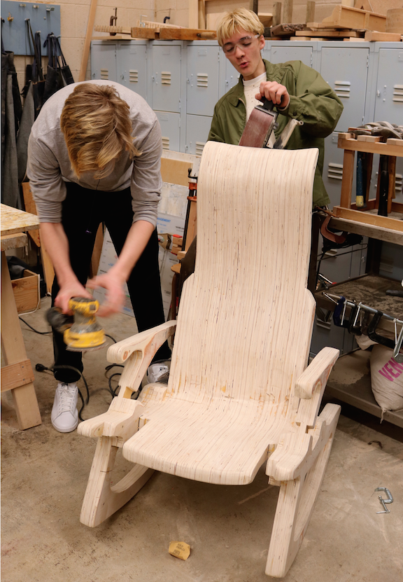 Juniors+Mason+Hitchman+and+Connor+Nickerson+sanding+away+at+their+hand+crafted+rocking+chair.+