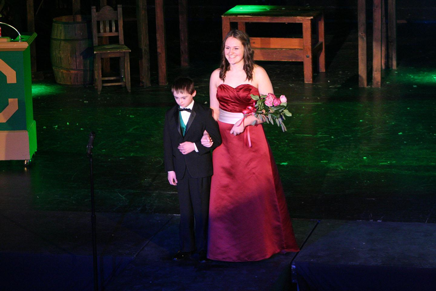 Kaytlin Gaines with her escort Thomas Gibson at the Rose Court voting assembly