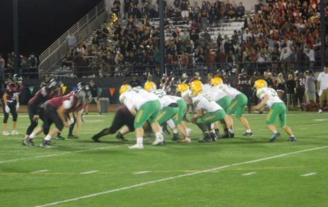 The Warriors' offense takes the field against Glencoe. Photo by Scotty Douglass