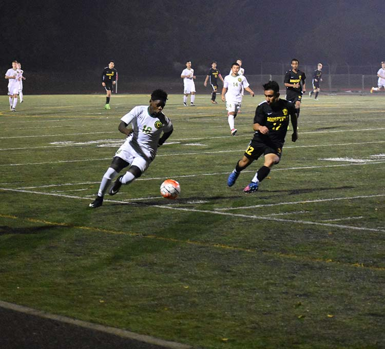 Mohammad Mohammad, freshman, takes on a Roosevelt defender in the second half. The Warriors won 3-0 on Oct. 17.