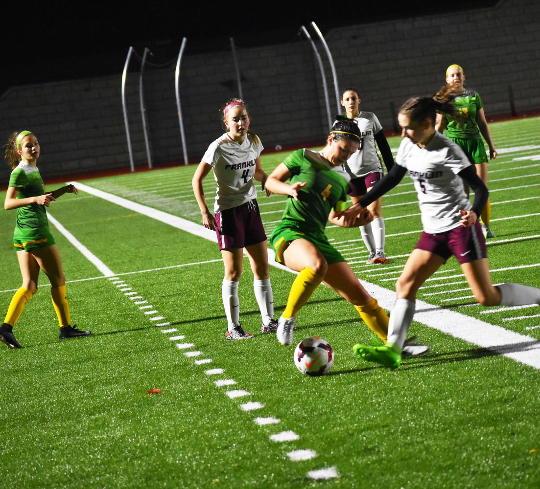 Senior Lauryn Ruegg maintains control of the ball in the final league match of the regular season Oct. 19 against Franklin. The Warriors won 7-0 and completed an undefeated regular season and first place finish in the Portland Interscholastic League.