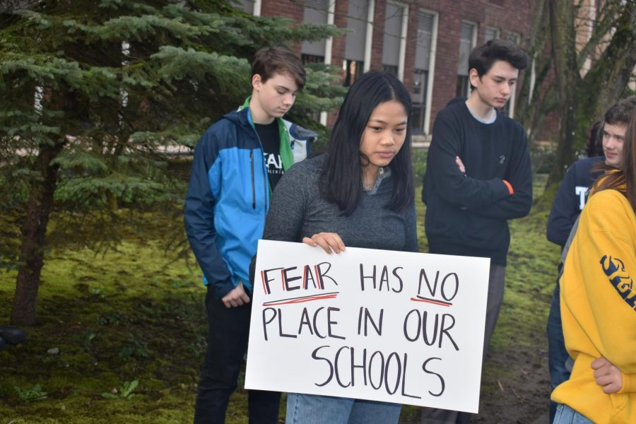 Students stand silently outside the school on March 14 for 17 minutes, honoring the 17 victims of the recent Florida school shooting and advocating for political action on ensuring safety in schools.