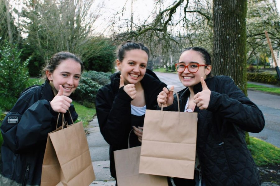Club founder Stephanie Singh, on far right, alongside friends Sofia Higgins and Vivi Hurley ready to pass out care packages.