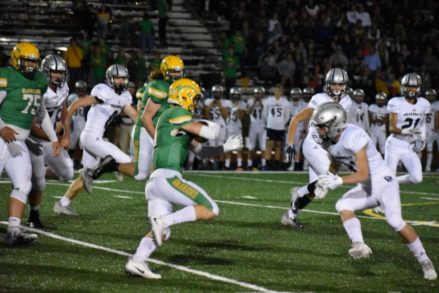 An unidentified player turns up field against Wilsonville Sept. 14. The Warriors lost 49-7 to fall to 0-3 on the year.