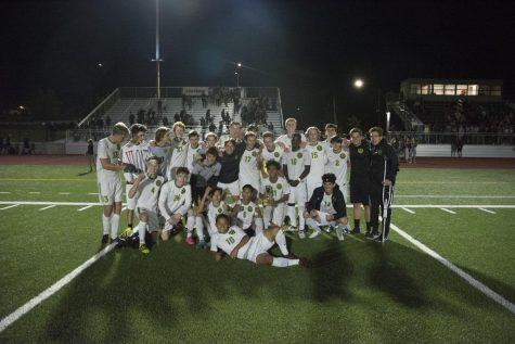 The varsity soccer team celebrates the 1-0 win over Franklin Sept. 25. Mo Mohamed scored the winning goal about 15 minutes into the second half. The victory meant the Warriors would bring the Southeast Cup home to Cleveland for the first time in two years.