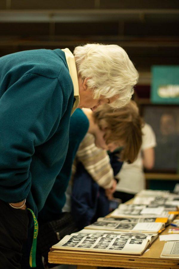 Jan Watt thoughtfully looks at past yearbooks