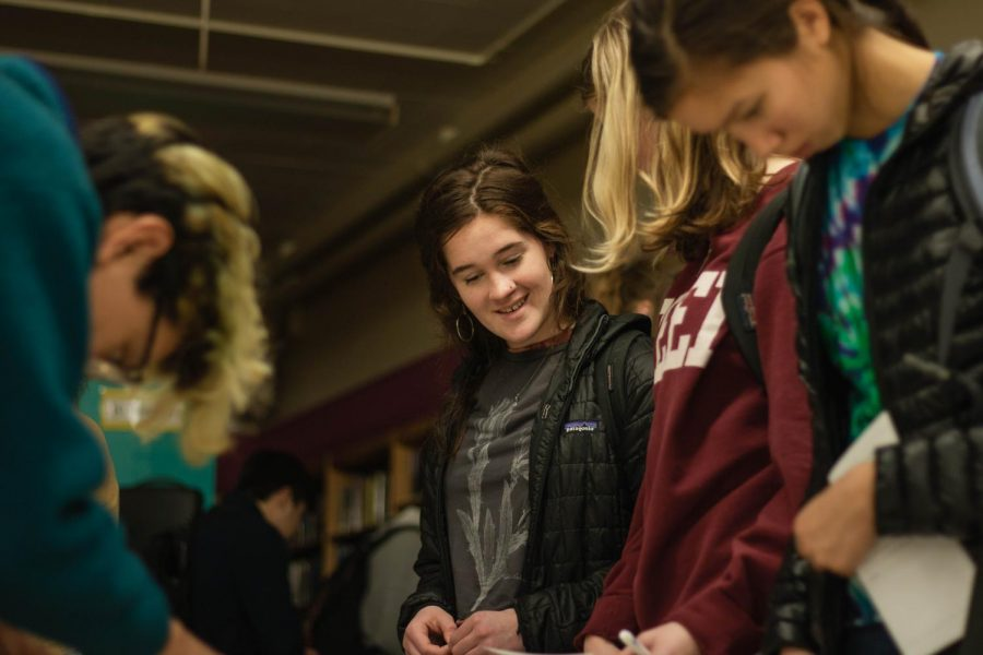 Students make comments and look at past Cleveland yearbooks