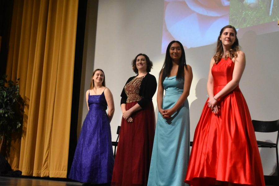 Cleveland's Rose Festival court candidates, from left to right: Sophia Mecklem, Abigail Kempter, Isabelle Gibson, and Lindsey Hausafus. After giving their speeches at the Rose Festival Assembly Feb. 28, the candidates enjoyed the traditional tea party in the library with family and friends, and then changed out of their gowns to participate in afternoon classes. The winner will be announced at an assembly March 11.