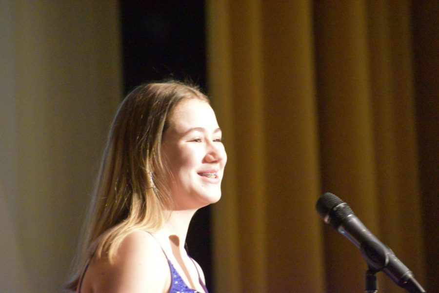 Sophia Mecklem, junior, talks about positivity  during her speech at the Rose Festival Assembly Feb. 28.