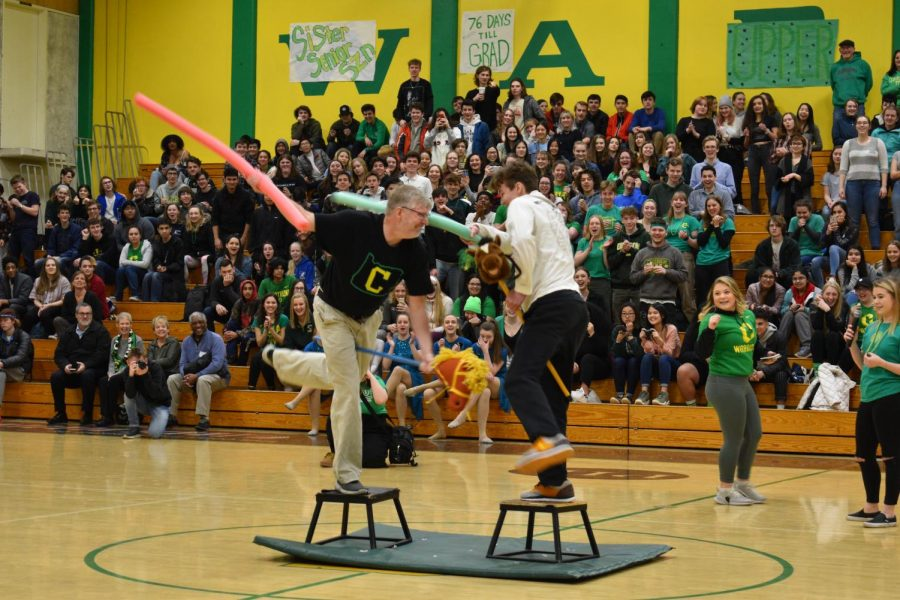 Mr. Running and a lower classmen joust with pool noodles
