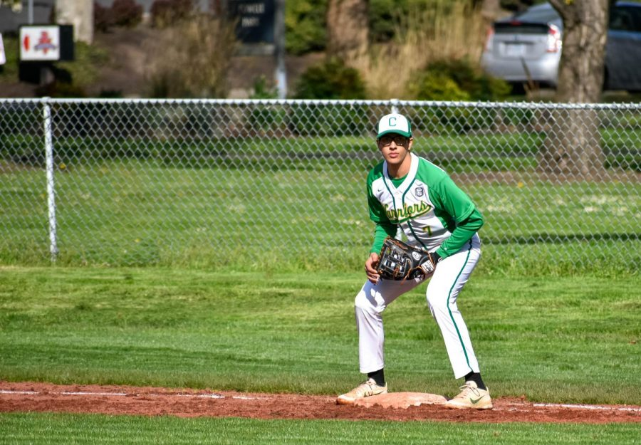 Junior Nick Brink awaits a pick off throw at first base against Benson on April 9, 2019. The Warriors won 10-0.