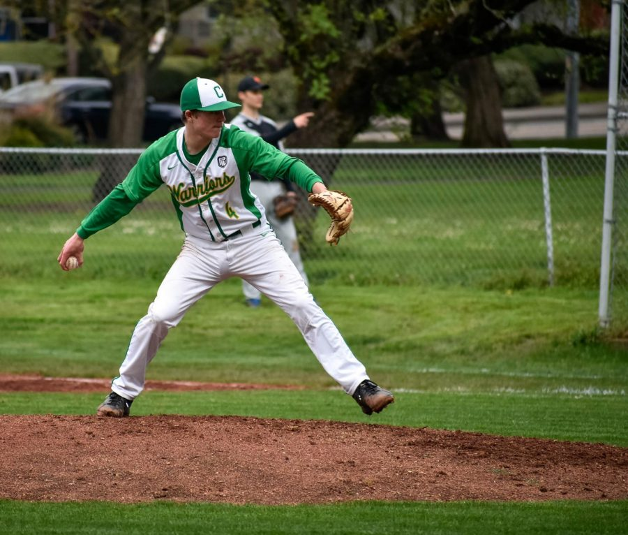 Senior Cole Gilhuly throws a fastball.