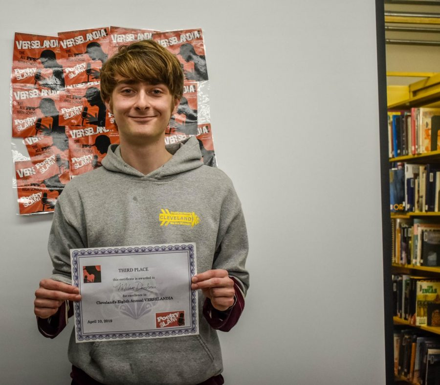 Senior Milan Donhowe claims third at Verselandia, a slam poetry competition at Cleveland on April 10, 2019.