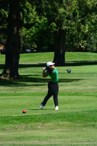 Freshman Kyra Ly hits a long drive during a match.