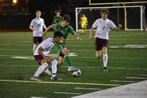 Senior Aidan Burns dribbles through Franklin defence