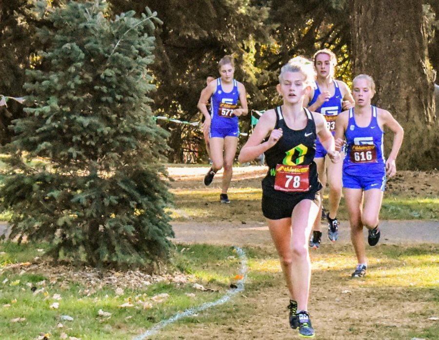 Senior, Aleen Golla leads the pack at PIL district meet at Lents Park.