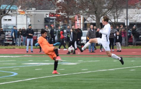 Harry Ritter-West goes for the ball at Gresham High School in the OSAA Quarterfinals