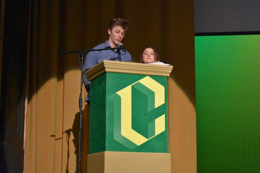 Warner Cole and Francesca Milhizer, student body presidents, announce the rules of the voting assembly.