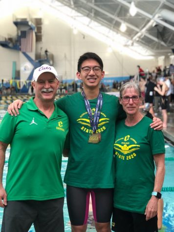Cody Soo poses with his coaches Mark Wren and Mollie Starr