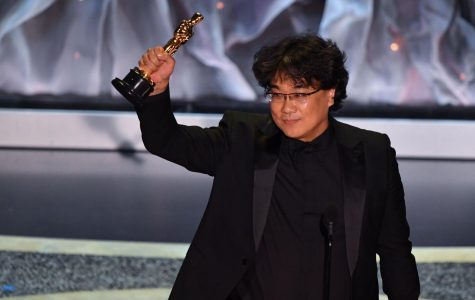 Bong Joon-Ho receives his long-awaited Oscar.  All photo rights go to ABC.