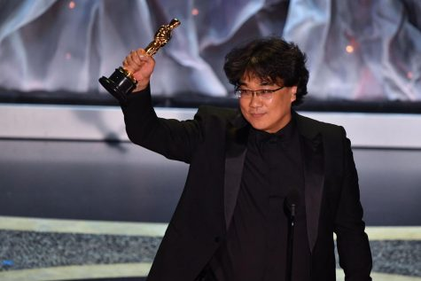 Bong Joon-Ho receives his long-awaited Oscar.  All photo rights go to ABC.