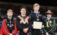 Freshman Logan Medford, second from right, takes third at the state tournament in wrestling at 126 pounds.
