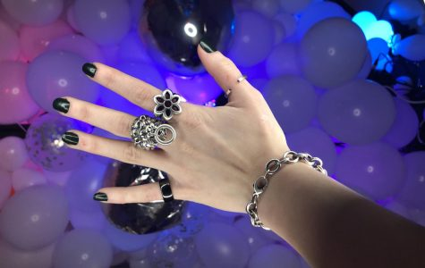 Karlea's favorite piece the Lion Head Ring on the middle finger, designed by King Baby an LA designer