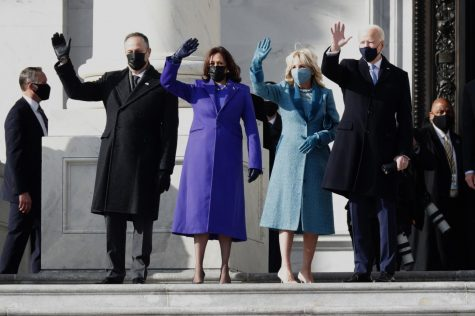 From left, Doug Emhoff, Kamala Harris, Jill Biden and Joe Biden arrive at the U.S. Capitol. (Carolyn Cole / Los Angeles Times)