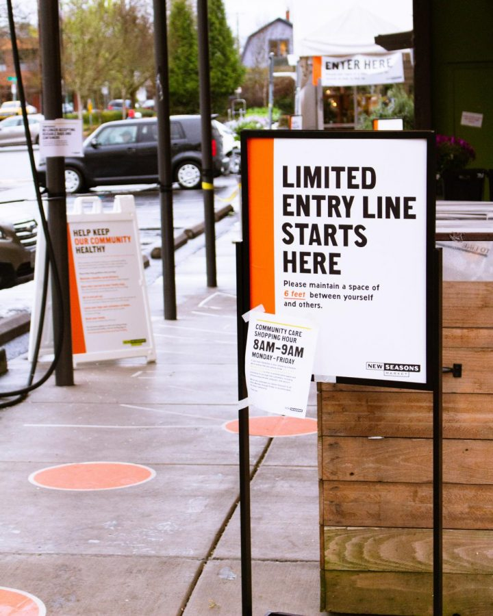 Due+to+the+recent+order+for+social+distancing+last+spring%2C+signs+like+this+were+put+up+in+every+grocery+store+across+Portland.