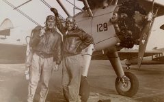 My great-grandfather, William Riley (right), with an unknown friend (left) standing in front of a plane during World War II.