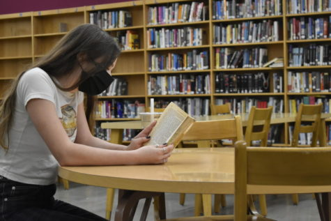 Nina Chait, senior, reads in the library, finding some quiet time during the day.