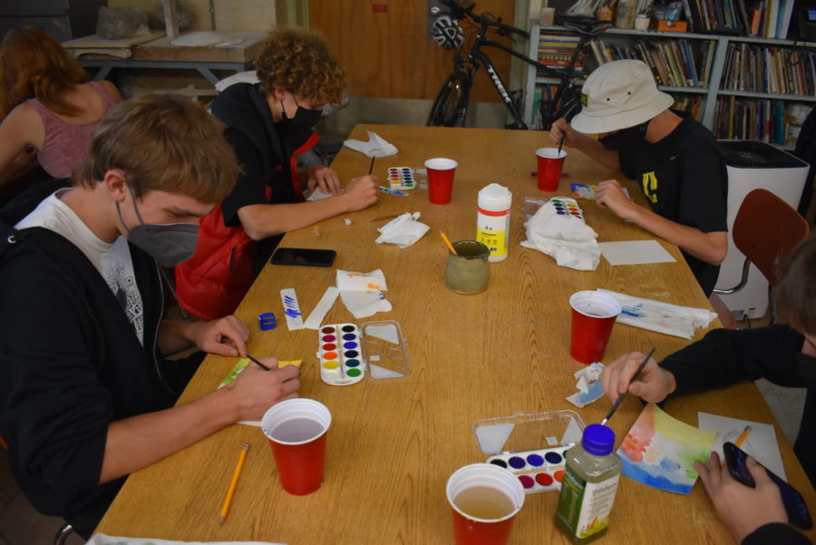 Grant Kloeppel Sophomore(Lower Left) Miles Jeffery Sophomore(Upper Left) and Cleveland Students painting in Ceramics class.