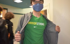 Liem Friel, senior, wears the school colors during green and yellow day.