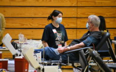 An adult volunteer gives blood at the Red Cross Blood Drive on Sept. 29.